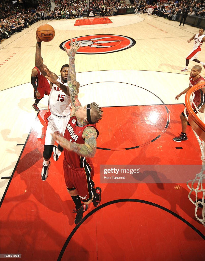 Amir Johnson #15 of the Toronto Raptors goes to the basket against Chris Andersen #11 of the Miami Heat during the game between the Toronto Raptors and the Miami Heat on March 17, 2013 at the Air Canada Centre in Toronto, Ontario, Canada.