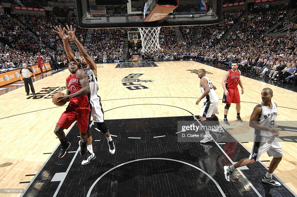 <a gi-track='captionPersonalityLinkClicked' href=/galleries/search?phrase=Amir+Johnson&family=editorial&specificpeople=556786 ng-click='$event.stopPropagation()'>Amir Johnson</a> #15 of the Toronto Raptors goes to the basket against <a gi-track='captionPersonalityLinkClicked' href=/galleries/search?phrase=Tim+Duncan&family=editorial&specificpeople=201467 ng-click='$event.stopPropagation()'>Tim Duncan</a> #21 of the San Antonio Spurs during the game between the Toronto Raptors and the San Antonio Spurs on December 26, 2012 at the AT&T Center in San Antonio, Texas.