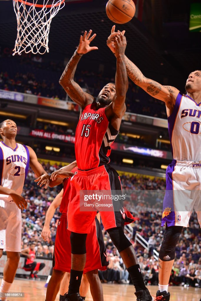 Amir Johnson #15 of the Toronto Raptors goes up for a rebound against the Phoenix Suns on March 6, 2013 at U.S. Airways Center in Phoenix, Arizona.