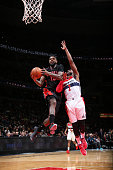 Amir Johnson of the Toronto Raptors goes up for a shot against the Washington Wizards on January 31 2015 at Verizon Center in Washington DC NOTE TO...