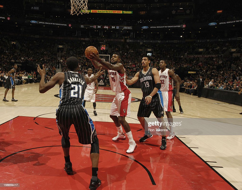 <a gi-track='captionPersonalityLinkClicked' href=/galleries/search?phrase=Amir+Johnson&family=editorial&specificpeople=556786 ng-click='$event.stopPropagation()'>Amir Johnson</a> #15 of the Toronto Raptors goes up for a shot vs the Orlando Magic during the game on November 18, 2012 at the Air Canada Centre in Toronto, Ontario, Canada.