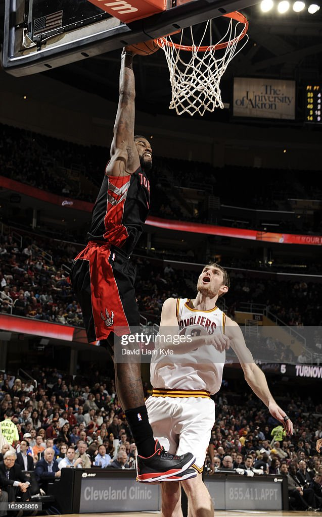 Amir Johnson #15 of the Toronto Raptors goes up for the dunk against Tyler Zeller #40 of the Cleveland Cavaliers at The Quicken Loans Arena on February 27, 2013 in Cleveland, Ohio.