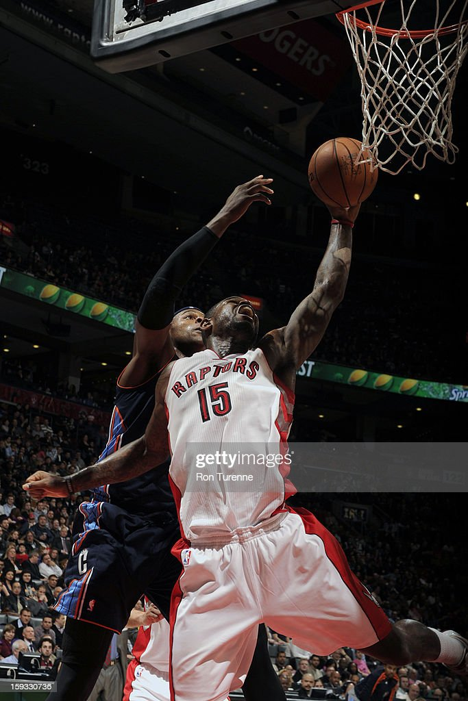 Amir Johnson #15 of the Toronto Raptors goes up strong to the basket against the of Charlotte Bobcats during the game on January 11, 2013 at the Air Canada Centre in Toronto, Ontario, Canada.