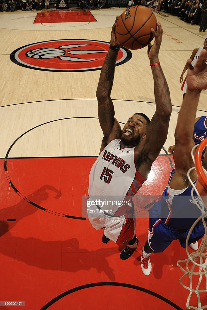 Amir Johnson #15 of the Toronto Raptors grabs a rebound against the Los Angeles Clippers on February 1, 2013 at the Air Canada Centre in Toronto, Ontario, Canada.