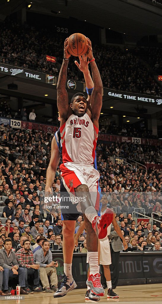 <a gi-track='captionPersonalityLinkClicked' href=/galleries/search?phrase=Amir+Johnson&family=editorial&specificpeople=556786 ng-click='$event.stopPropagation()'>Amir Johnson</a> #15 of the Toronto Raptors grabs a rebound against the Dallas Mavericks on December 14, 2012 at the Air Canada Centre in Toronto, Ontario, Canada.
