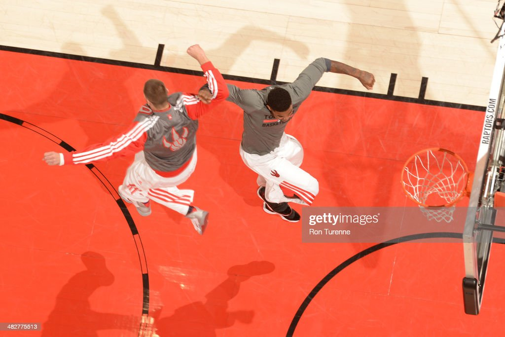 <a gi-track='captionPersonalityLinkClicked' href=/galleries/search?phrase=Amir+Johnson&family=editorial&specificpeople=556786 ng-click='$event.stopPropagation()'>Amir Johnson</a> #15 of the Toronto Raptors greets teammates before the game against the Boston Celtics on March 28, 2014 at the Air Canada Centre in Toronto, Ontario, Canada.