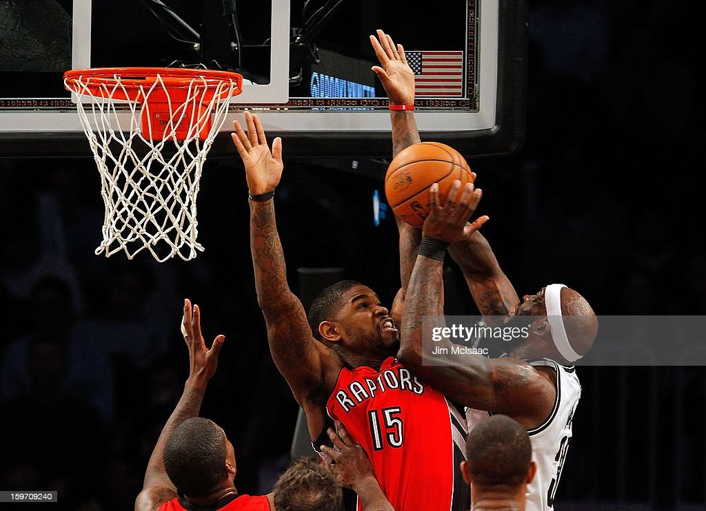 Amir Johnson #15 of the Toronto Raptors in action against Reggie Evans #30 of the Brooklyn Nets at Barclays Center on January 15, 2013 in the Brooklyn borough of New York City.The Nets defeated the Raptors 113-106.