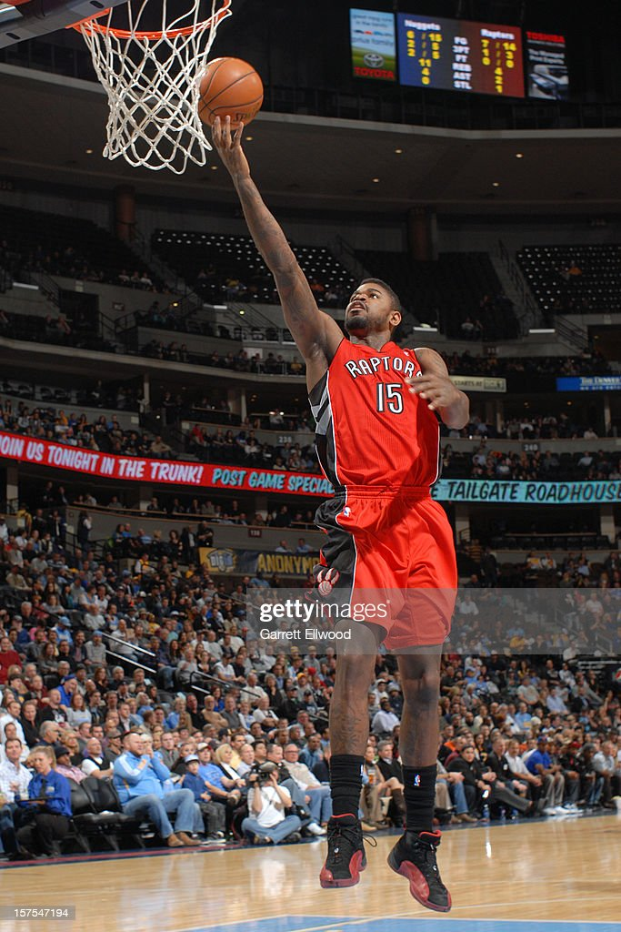 Amir Johnson #15 of the Toronto Raptors lays the ball up against the Denver Nuggets on December 3, 2012 at the Pepsi Center in Denver, Colorado.