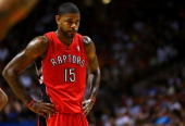 Amir Johnson of the Toronto Raptors looks on during a game against the Miami Heat at AmericanAirlines Arena on January 5 2014 in Miami Florida NOTE...