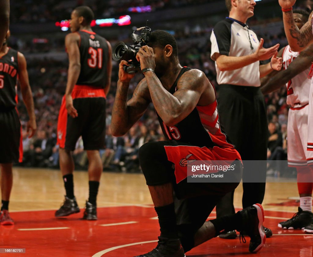 <a gi-track='captionPersonalityLinkClicked' href=/galleries/search?phrase=Amir+Johnson&family=editorial&specificpeople=556786 ng-click='$event.stopPropagation()'>Amir Johnson</a> #15 of the Toronto Raptors pretends to take a picture with a remote camera that was kicked onto the floor during a game against the Chicago Bulls at the United Center on April 9, 2013 in Chicago, Illinois. The Raptos defeated the Bulls 101-98.