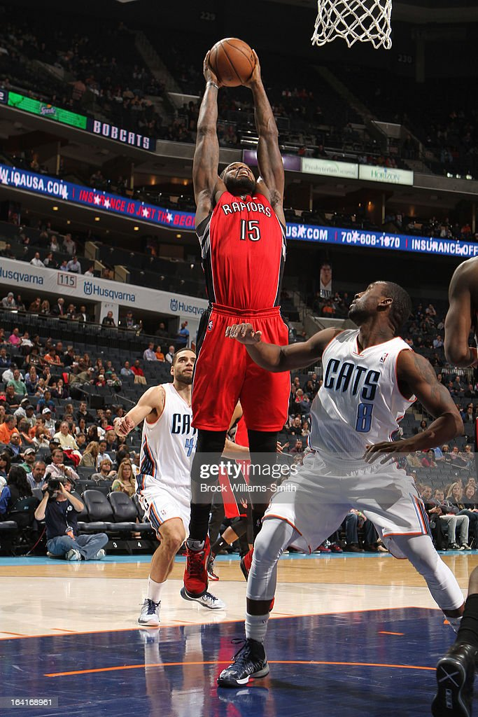 Amir Johnson #15 of the Toronto Raptors rebounds against Ben Gordon #8 of the Charlotte Bobcats at the Time Warner Cable Arena on March 20, 2013 in Charlotte, North Carolina.
