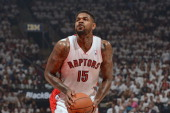 Amir Johnson of the Toronto Raptors shoots a foul shot in Game Five of the Eastern Conference Quarterfinals against the Brooklyn Nets furing the 2014...