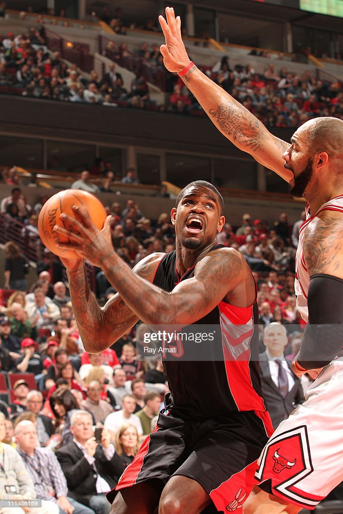 <a gi-track='captionPersonalityLinkClicked' href=/galleries/search?phrase=Amir+Johnson&family=editorial&specificpeople=556786 ng-click='$event.stopPropagation()'>Amir Johnson</a> #15 of the Toronto Raptors shoots against <a gi-track='captionPersonalityLinkClicked' href=/galleries/search?phrase=Carlos+Boozer&family=editorial&specificpeople=201638 ng-click='$event.stopPropagation()'>Carlos Boozer</a> #5 of the Chicago Bulls on April 2, 2011 at the United Center in Chicago, Illinois.