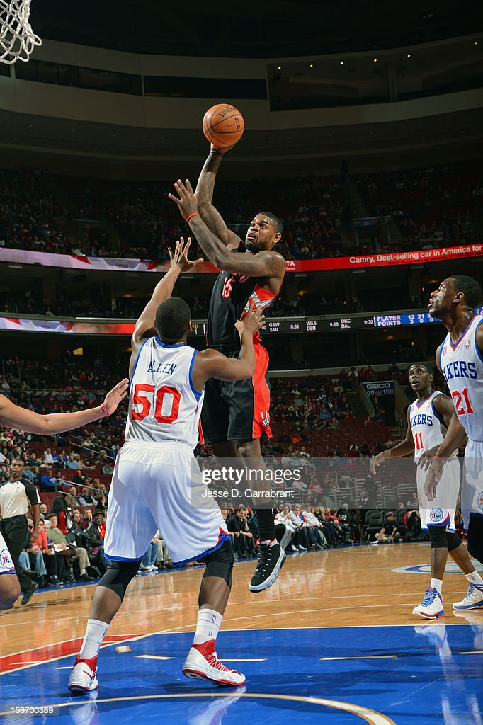 Amir Johnson #15 of the Toronto Raptors shoots against Lavoy Allen #50 of the Philadelphia 76ers during the game at the Wells Fargo Center on January 18, 2013 in Philadelphia, Pennsylvania.