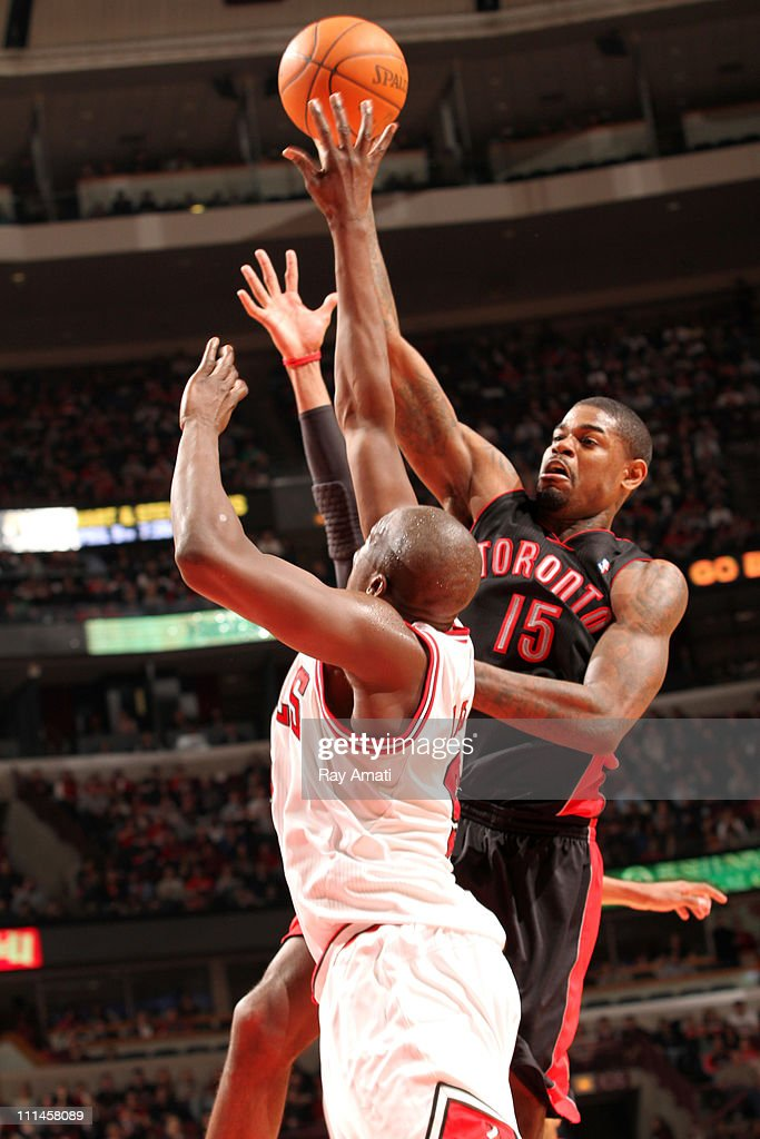 <a gi-track='captionPersonalityLinkClicked' href=/galleries/search?phrase=Amir+Johnson&family=editorial&specificpeople=556786 ng-click='$event.stopPropagation()'>Amir Johnson</a> #15 of the Toronto Raptors shoots against <a gi-track='captionPersonalityLinkClicked' href=/galleries/search?phrase=Luol+Deng&family=editorial&specificpeople=202830 ng-click='$event.stopPropagation()'>Luol Deng</a> #9 of the Chicago Bulls on April 2, 2011 at the United Center in Chicago, Illinois.