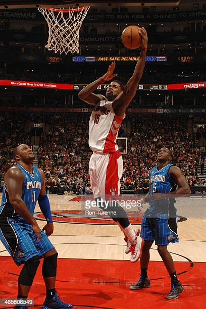 Amir Johnson of the Toronto Raptors shoots against the Orlando Magic on January 29 2014 at the Air Canada Centre in Toronto Ontario Canada NOTE TO...