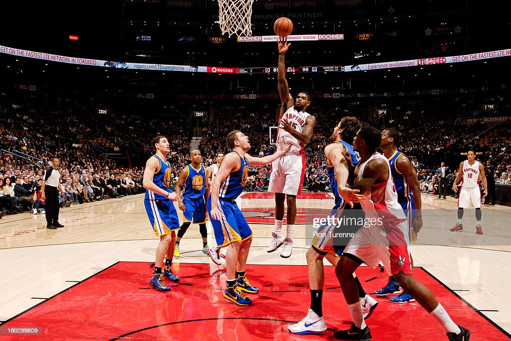 <a gi-track='captionPersonalityLinkClicked' href=/galleries/search?phrase=Amir+Johnson&family=editorial&specificpeople=556786 ng-click='$event.stopPropagation()'>Amir Johnson</a> #15 of the Toronto Raptors shoots in the lane against David Lee #10 of the Golden State Warriors on January 28, 2013 at the Air Canada Centre in Toronto, Ontario, Canada.