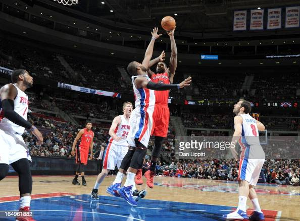 Amir Johnson of the Toronto Raptors shoots the ball under pressure during the game between the Detroit Pistons and the Toronto Raptors on March 29...