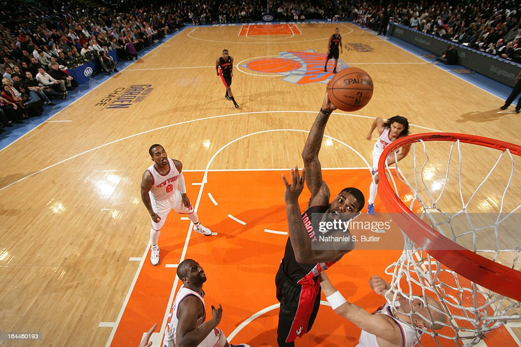 <a gi-track='captionPersonalityLinkClicked' href=/galleries/search?phrase=Amir+Johnson&family=editorial&specificpeople=556786 ng-click='$event.stopPropagation()'>Amir Johnson</a> #15 of the Toronto Raptors shoots while playing in a game against the New York Knicks on March 23, 2013 at Madison Square Garden in New York City.