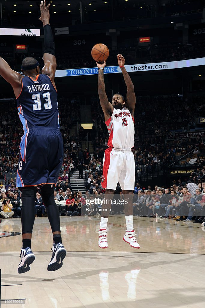 Amir Johnson #15 of the Toronto Raptors takes a shot against the Charlotte Bobcats on January 11, 2013 at the Air Canada Centre in Toronto, Ontario, Canada.
