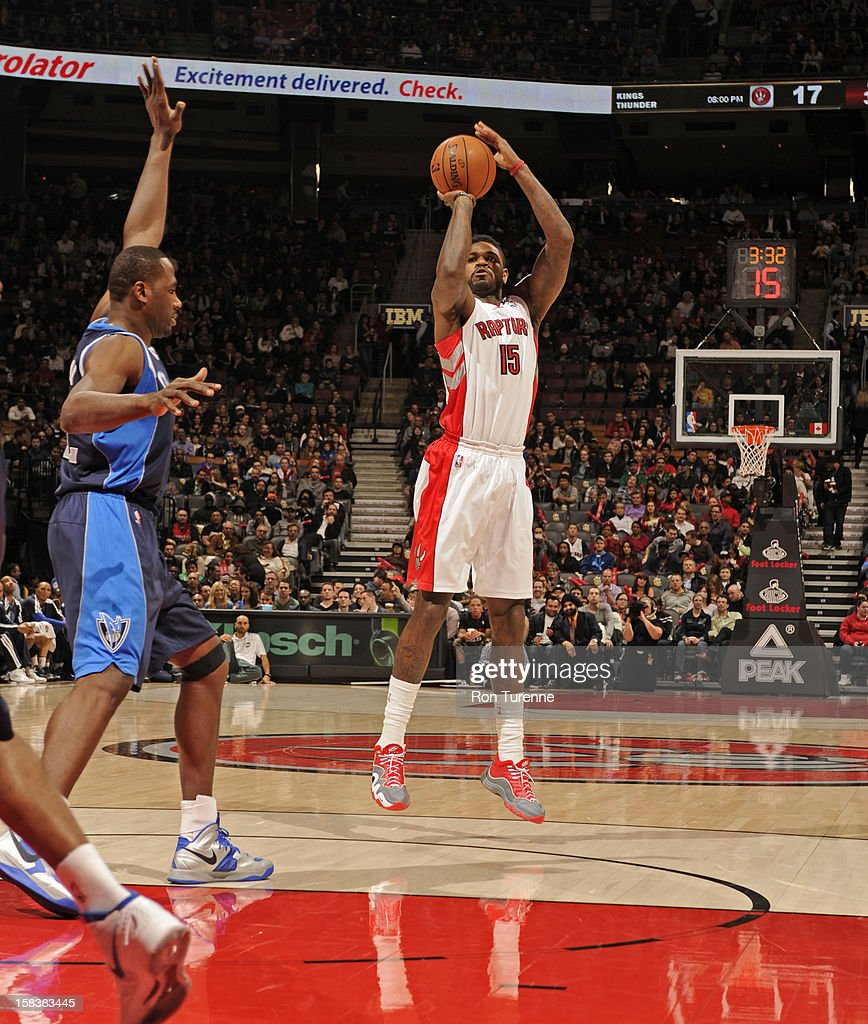 Amir Johnson #15 of the Toronto Raptors takes a shot against the Dallas Mavericks on December 14, 2012 at the Air Canada Centre in Toronto, Ontario, Canada.
