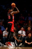 Amir Johnson of the Toronto Raptors takes a shot in the first half against the Brooklyn Nets in Game Three of the Eastern Conference Quarterfinals...