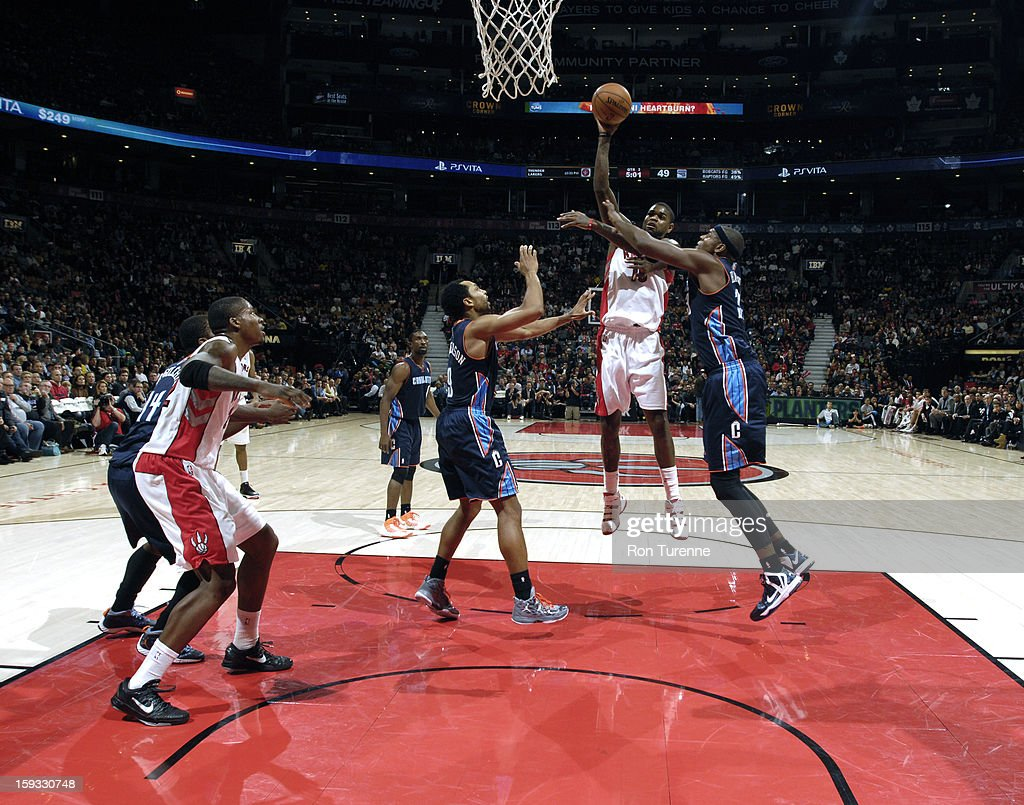 Amir Johnson #15 of the Toronto Raptors takes a shot in traffic against the Charlotte Bobcats during the game on January 11, 2013 at the Air Canada Centre in Toronto, Ontario, Canada.