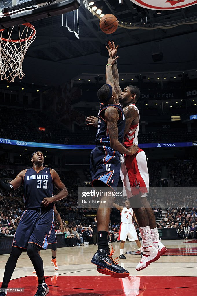Amir Johnson #15 of the Toronto Raptors takes a shot over Tyrus Thomas #12 of the Charlotte Bobcats on January 11, 2013 at the Air Canada Centre in Toronto, Ontario, Canada.