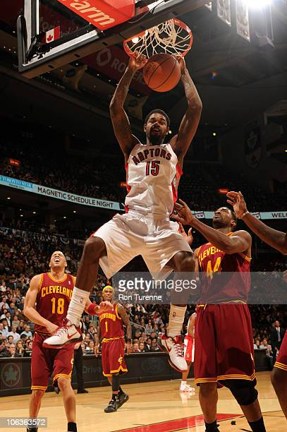 Amir Johnson of the Toronto Raptors throws down the twohanded jam ahead of Leon Powe of the Cleveland Cavaliers during a game on October 29 2010 at...