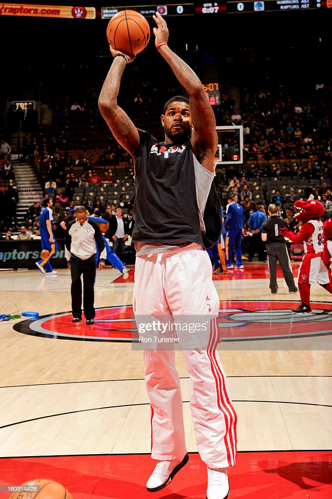 Amir Johnson #15 of the Toronto Raptors warms up before playing the Golden State Warriors on January 28, 2013 at the Air Canada Centre in Toronto, Ontario, Canada.