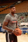 Amir Johnson of the Toronto Raptors warms up before the game against the Utah Jazz on November 9 2013 at the Air Canada Centre in Toronto Ontario...