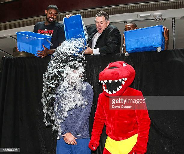 TORONTO ON AUGUST 20 Amir Johnson Tim Leiweke and Jermain Defoe get Nazem Kadri in the Ice Bucket Challenge outside the Air Canada Centre August 20...