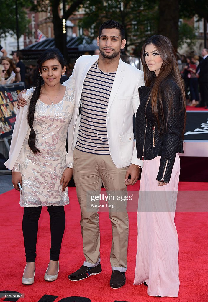 Amir Khan (C) and Faryal Makhdoom (R) attend the World Premiere of 'One Direction: This Is Us' at Empire Leicester Square on August 20, 2013 in London, England.