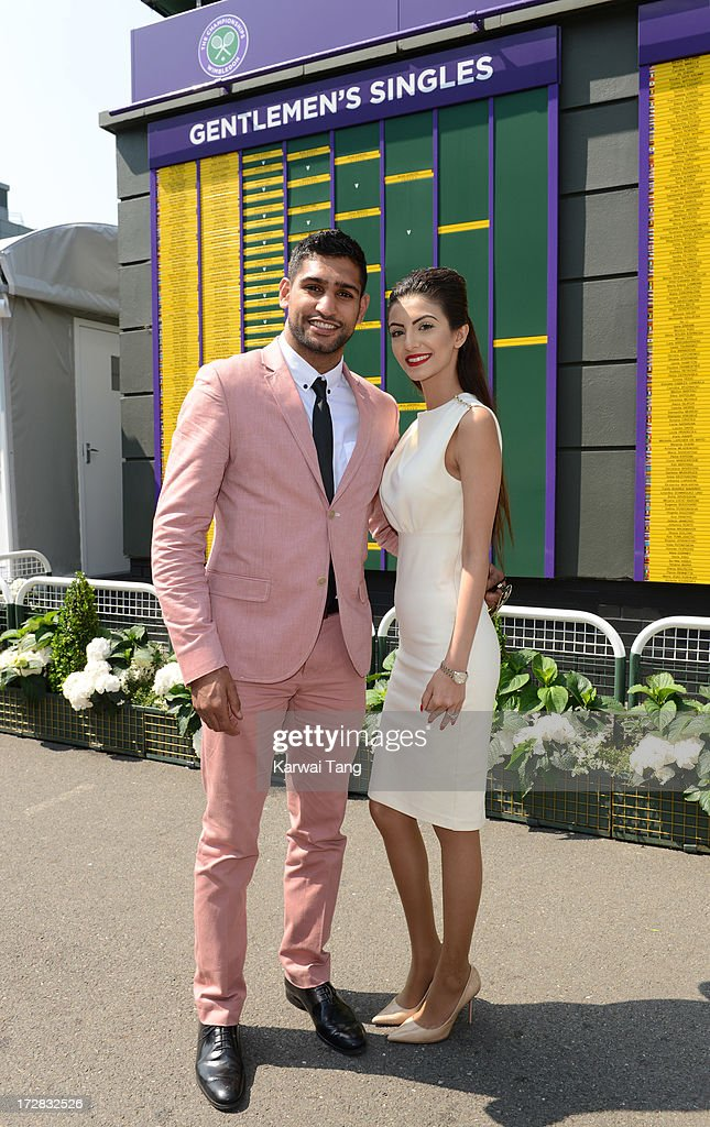 <a gi-track='captionPersonalityLinkClicked' href=/galleries/search?phrase=Amir+Khan+-+Boxer&family=editorial&specificpeople=162795 ng-click='$event.stopPropagation()'>Amir Khan</a> and his wife Faryal Makhdoom attend Day 11 of the Wimbledon Lawn Tennis Championships at the All England Lawn Tennis and Croquet Club on July 5, 2013 in London, England.
