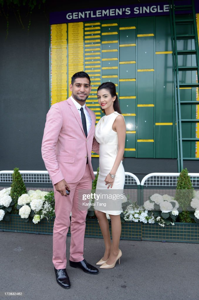 <a gi-track='captionPersonalityLinkClicked' href=/galleries/search?phrase=Amir+Khan+-+Boxer&family=editorial&specificpeople=162795 ng-click='$event.stopPropagation()'>Amir Khan</a> and his wife Faryal Makhdoom attends Day 11 of the Wimbledon Lawn Tennis Championships at the All England Lawn Tennis and Croquet Club on July 5, 2013 in London, England.