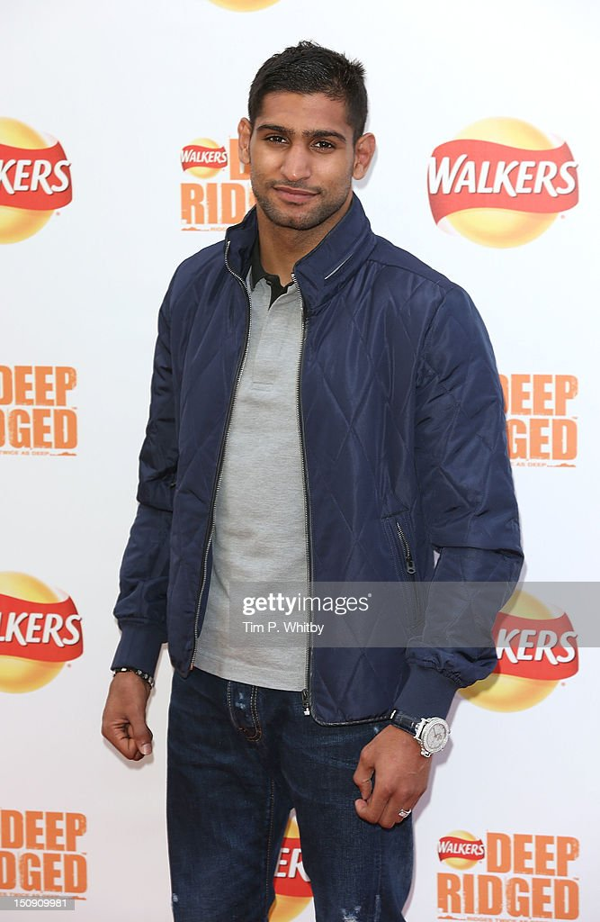 Amir Khan attends the launch of Walkers Deep Ridged crisp at The Old Truman Brewery on August 29 2012 in London England