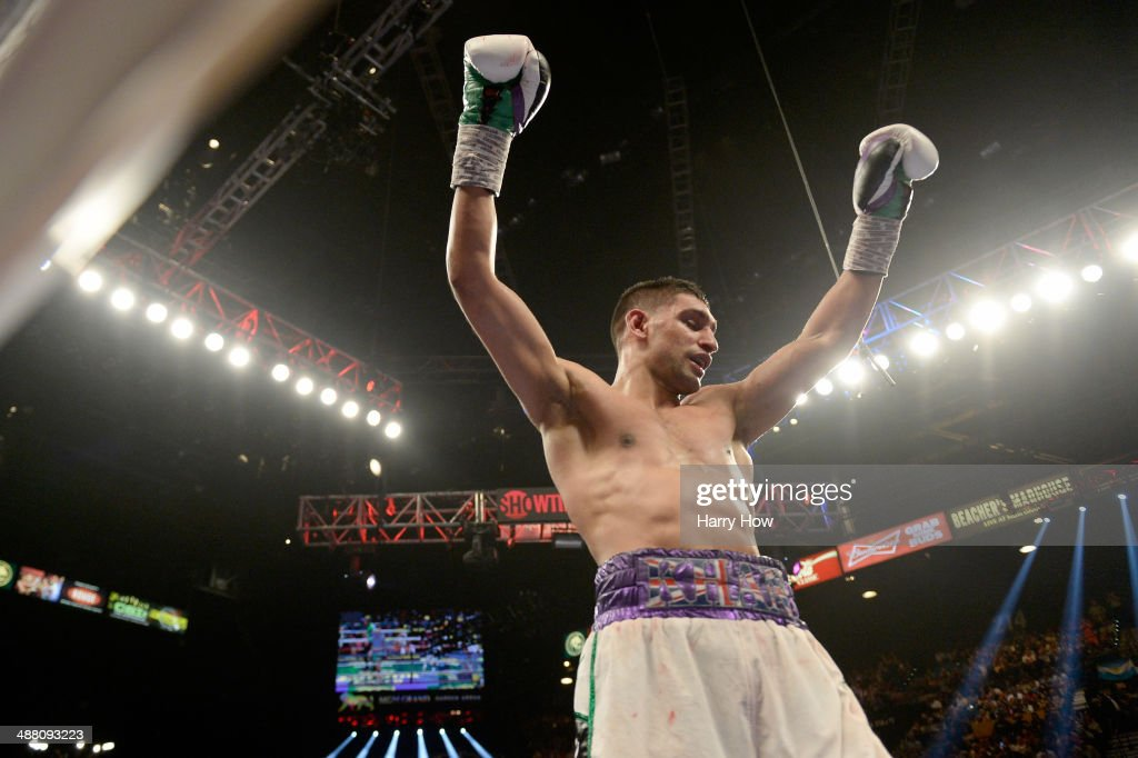 Amir Khan celebrates after the 12th round against Luis Collazo during their welterweight bout at the MGM Grand Garden Arena on May 3 2014 in Las...