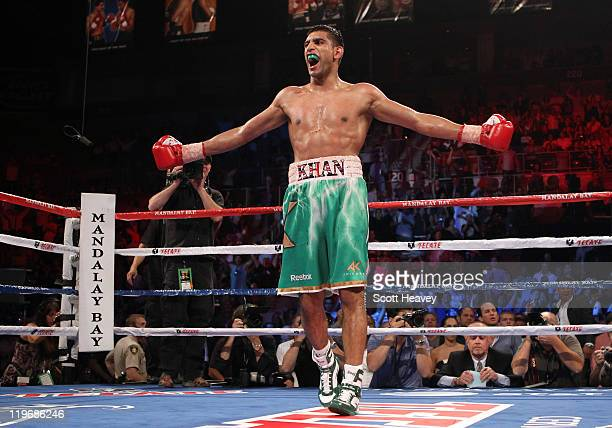 Amir Khan celebrates his fifth round knockout of Zab Judah in their super lightweight world championship unification bout at Mandalay Bay Events...