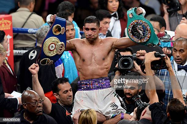 Amir Khan celebrates his unanimousdecision victory over Luis Collazo after their welterweight bout at the MGM Grand Garden Arena on May 3 2014 in Las...