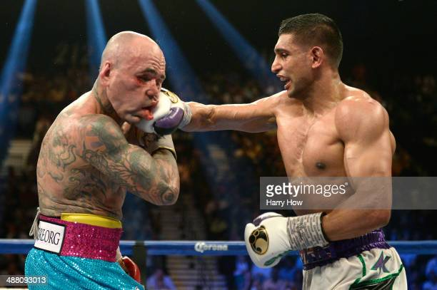Amir Khan connects with a right at Luis Collazo during their welterweight bout at the MGM Grand Garden Arena on May 3 2014 in Las Vegas Nevada
