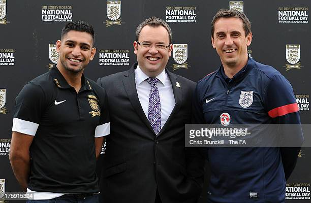 Amir Khan FA General Secretary Alex Horne and Gary Neville attend The FA's Sir Bobby Robson National Football Day on August 10 2013 in Manchester...