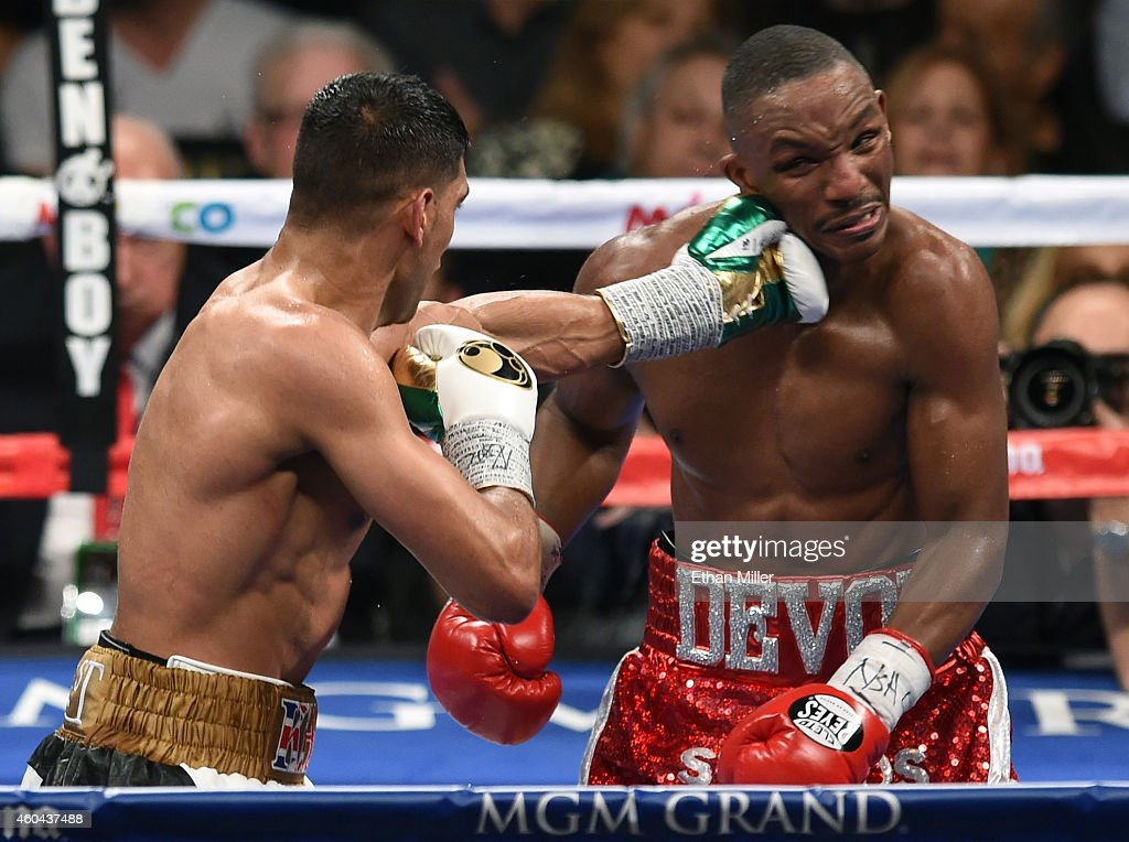 Amir Khan hits Devon Alexander in the sixth round of their welterweight bout at the MGM Grand Garden Arena on December 13 2014 in Las Vegas Nevada