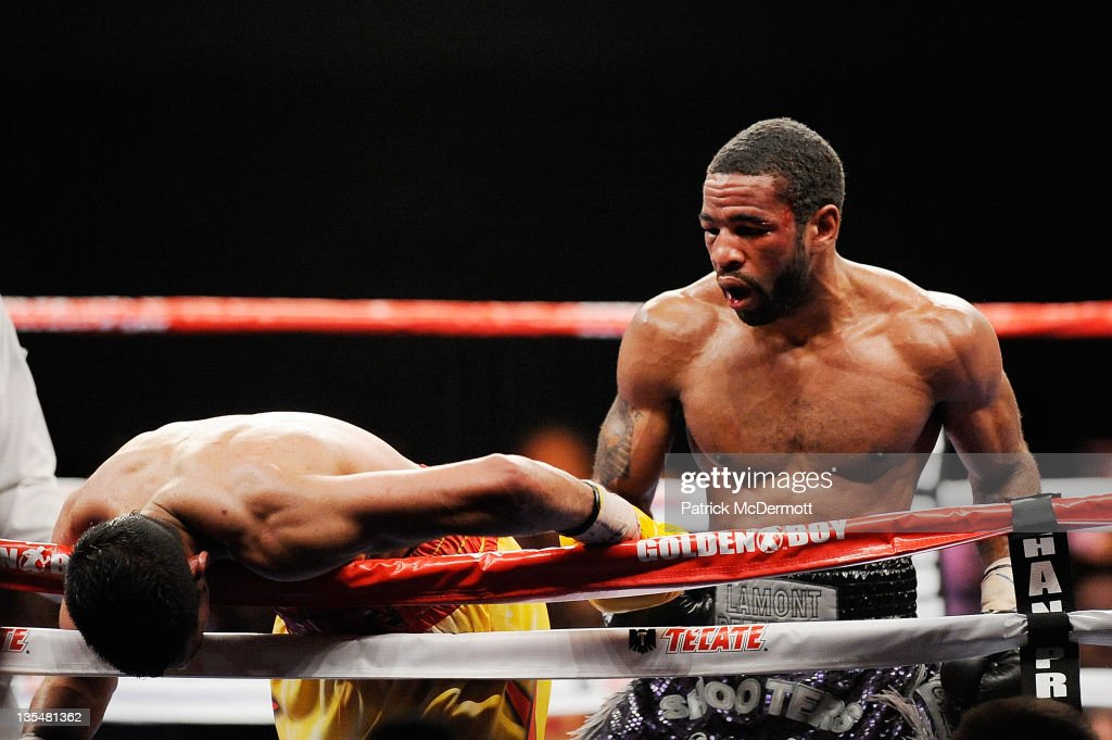 Amir Khan is knocked down by Lamont Peterson during the Capital Showdown Khan v Peterson WBA/IBF World lightwelterweight title bout at Washington...