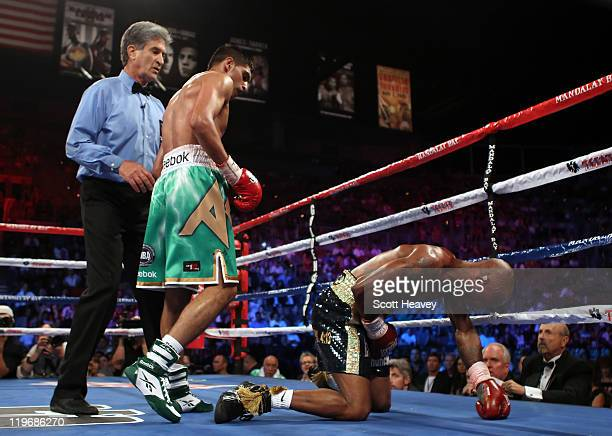 Amir Khan knocks out Zab Judah in the fifth round during their super lightweight world championship unification bout at Mandalay Bay Events Center on...