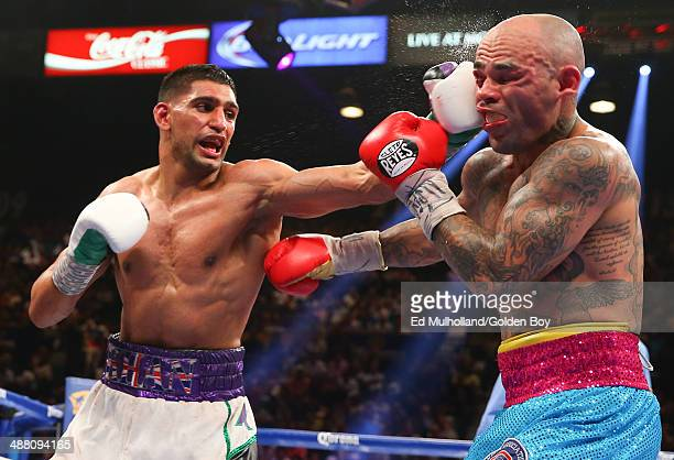 Amir Khan lands a left hand to the head of Luis Collazo during their welterweight bout at the MGM Grand Garden Arena on May 3 2014 in Las Vegas Nevada