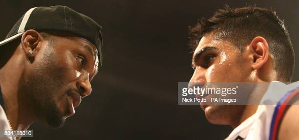 Amir Khan listens to his trainer before the Commonwealth Lightweight Title bout at ExCel Arena London
