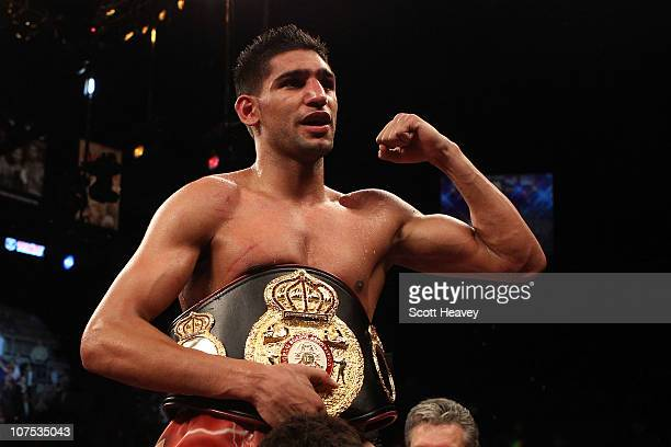 Amir Khan of England celebrates after his unanimous decision victory against Marcos Maidana of Argentina after their WBA super lightweight title...
