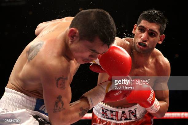 Amir Khan of England connects with a right to the face of Marcos Maidana of Argentina during the WBA super lightweight title fight at Mandalay Bay...