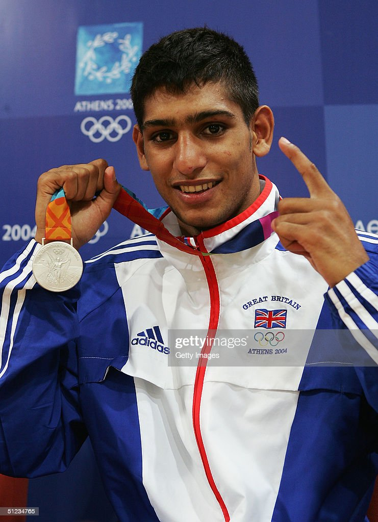 Amir Khan of Great Britain poses with his bronze medal for the men's boxing 60 kg event on August 29 2004 during the Athens 2004 Summer Olympic Games...