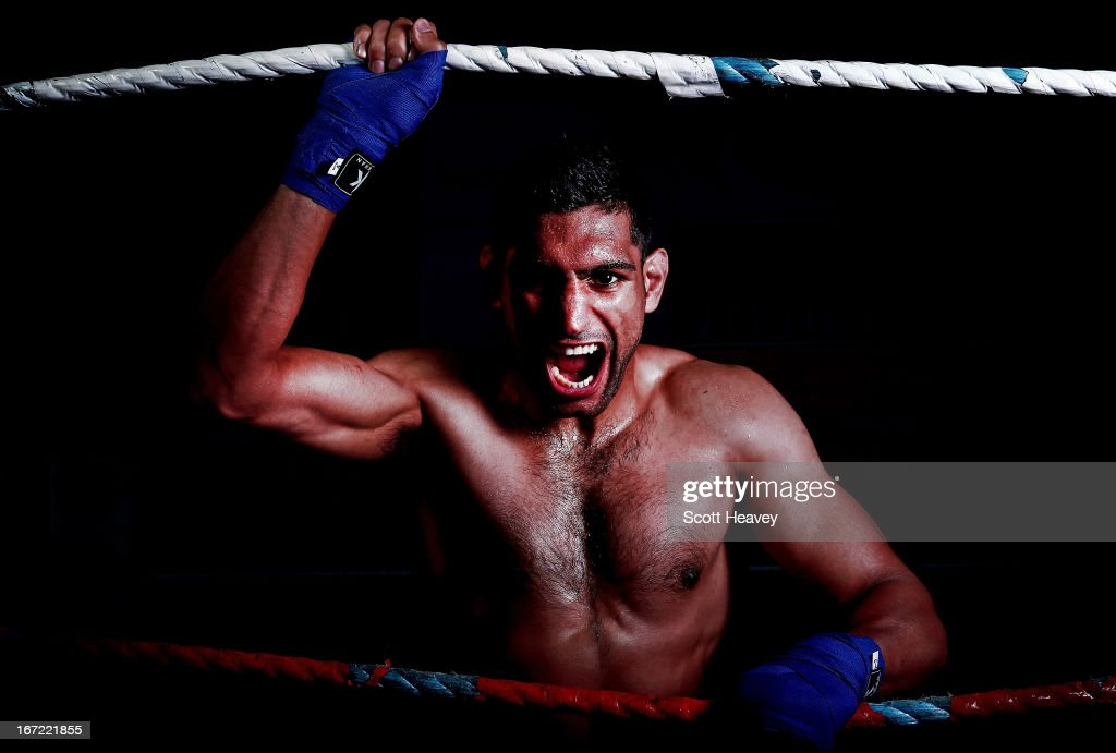 Amir Khan poses during a photo shoot at Gloves Gym on April 22 2013 in Bolton England